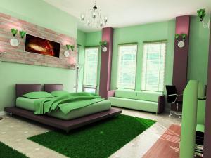 Стены и части мебели оформлены в зеленый цвет